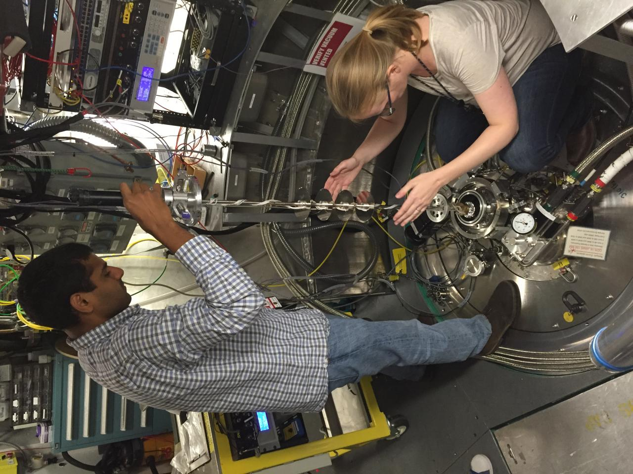 Loading sample into ARCS chamber.